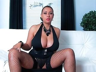 Matures Dark Haired With Big Bumpers Is Wearing Black Fishnets And Playing With Her Gash On The Sofa