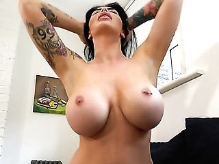 Tattooed Dark Haired Maxi Rhodes Loves Flashing Her Awesome Big Melons