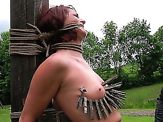 Well-worn Out Crimson-haired Mummy Gets Her Tits And Belly Squeezed With Pegs